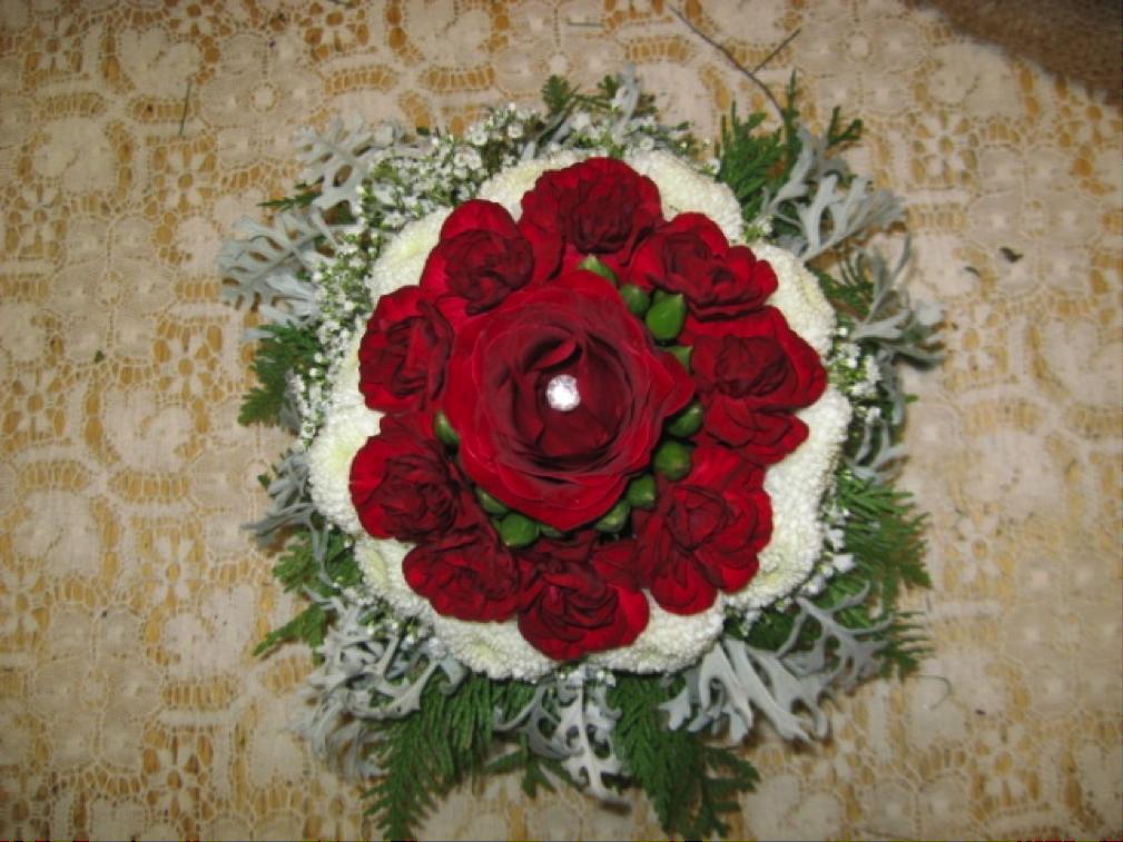 Red holiday flower arrangement