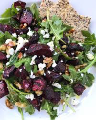 A salad of beet, arugula, and feta cheese